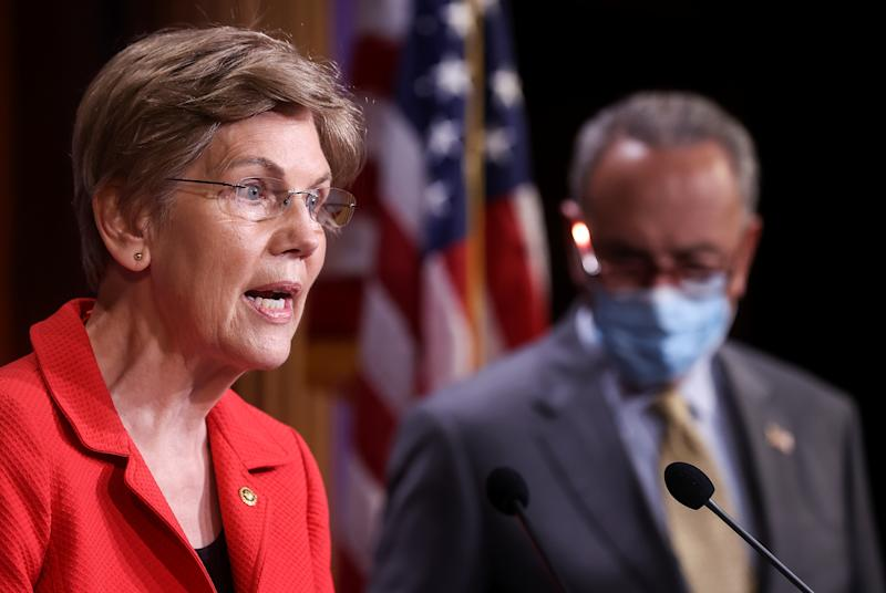 U.S. Senator Elizabeth Warren (D-MA) speaks to reporters with Senate Majority Leader Chuck Schumer (D-NY) during a news conference on Democrats' demand for an extension of eviction protections in the next coronavirus disease (COVID-19) aid bill on Capitol Hill in Washington, U.S., July 22, 2020. REUTERS/Jonathan Ernst