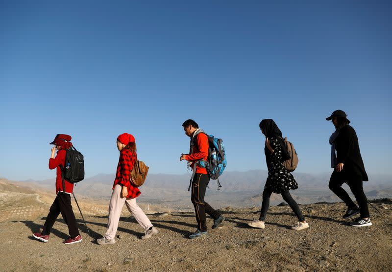 Afghan Hikeventures members walk in mountain on outskirts of Kabul