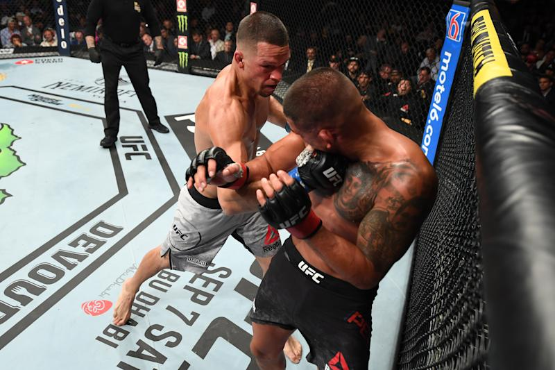 ANAHEIM, CALIFORNIA - AUGUST 17: (L-R) Nate Diaz punches Anthony Pettis in their welterweight bout during the UFC 241 event at the Honda Center on August 17, 2019 in Anaheim, California. (Photo by Josh Hedges/Zuffa LLC/Zuffa LLC via Getty Images)