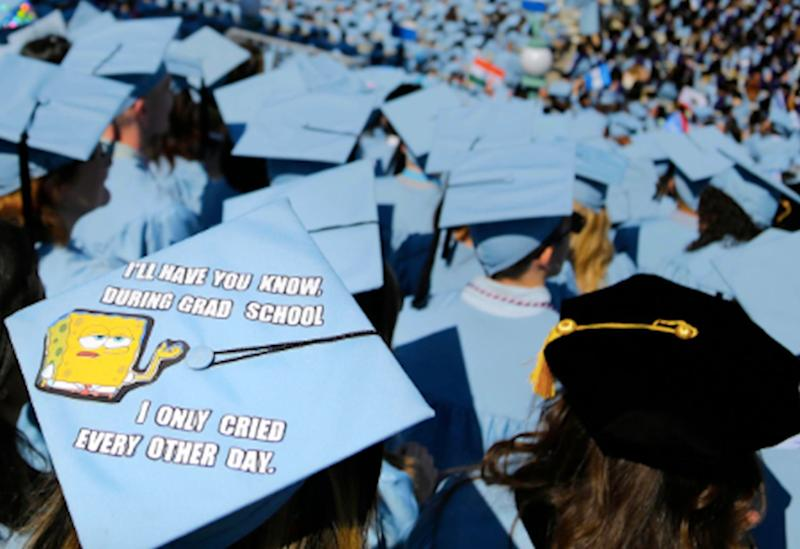 In this Wednesday, May 17, 2017, file photo, graduating students fill the Columbia University campus during a graduation ceremony in New York. Having college debt disappear is something many student loan holders can only dream of. (AP Photo/Seth Wenig, File)