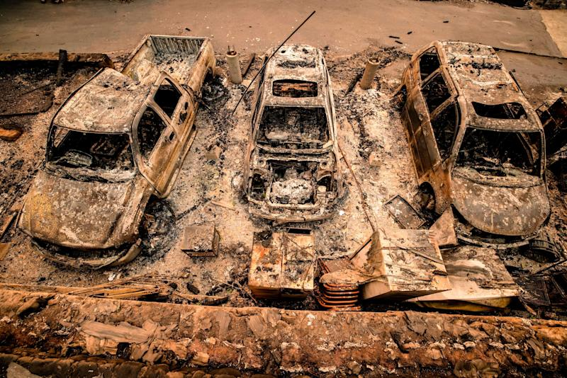 The charred remains of cars are lined up outside a home in Napa Valley on Monday.