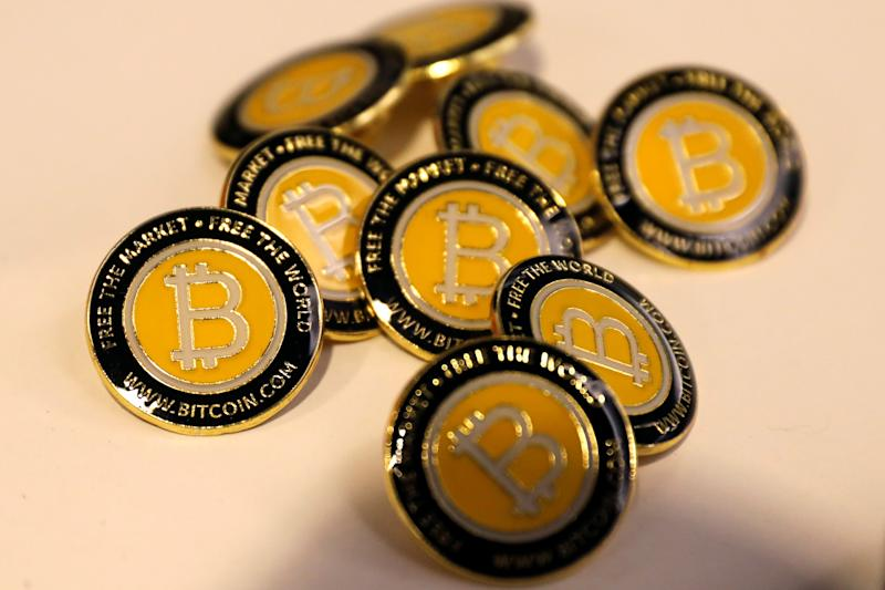 Bitcoin.com buttons are seen displayed on the floor of the Consensus 2018 blockchain technology conference in New York City, New York, U.S., May 16, 2018. REUTERS/Mike Segar
