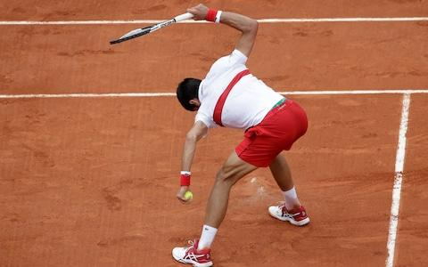 Serbia's Novak Djokovic breaks his racket during his third round match of the French Open tennis tournament against Spain's Roberto Bautista Agut at the Roland Garros stadium in Paris, France, Friday, June 1, 2018 - Credit: AP