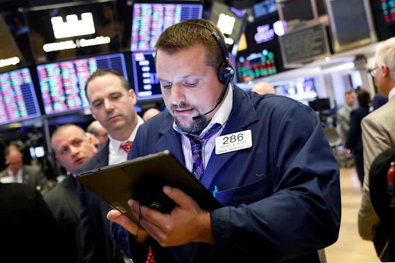 Traders work on the floor at the New York Stock Exchange (NYSE) in New York, U.S., September 23, 2019. REUTERS/Brendan McDermid