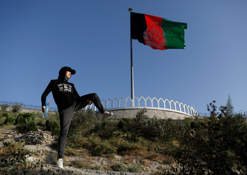Fatima Sultani, 18 a member of Hikeventures mountaineering team, excercises on a hilltop in Kabul