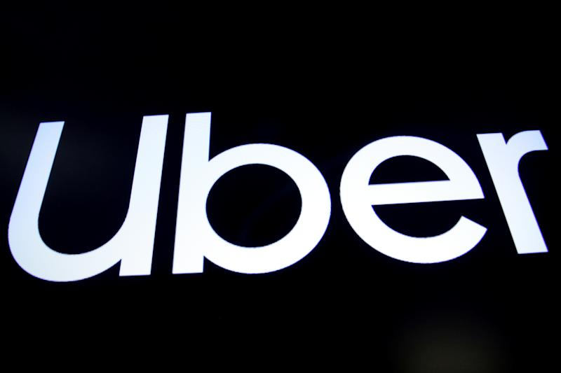 A screen displays the company logo for Uber Technologies Inc. on the day of it's IPO at the New York Stock Exchange (NYSE) in New York, U.S., May 10, 2019. REUTERS/Brendan McDermid