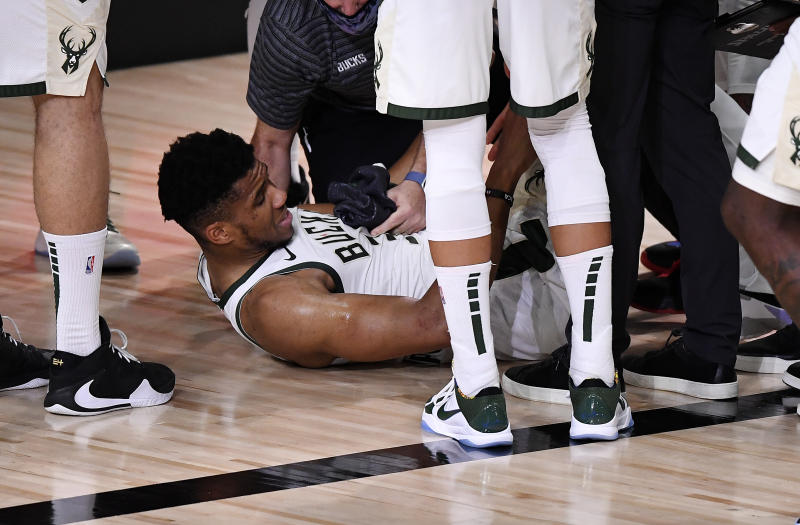 Giannis Antetokounmpo #34 of the Milwaukee Bucks exits the game after an injury during the second quarter against the Miami Heat in Game Four of the Eastern Conference Second Round