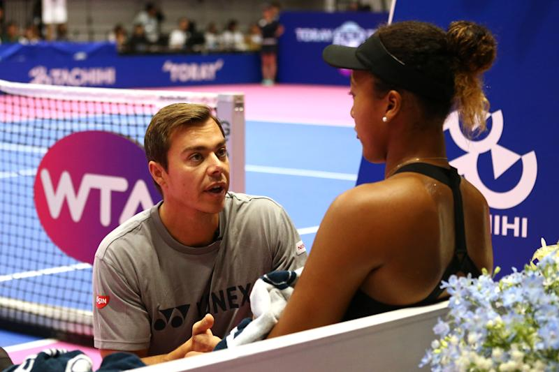 TACHIKAWA, JAPAN - SEPTEMBER 23: Naomi Osaka of Japan is talked by her coach Sascha Bajin in the final against Karolina Pliskova of the Czech Republic on day seven of the Toray Pan Pacific Open at Arena Tachikawa Tachihi on September 23, 2018 in Tachikawa, Tokyo, Japan. (Photo by Koji Watanabe/Getty Images)