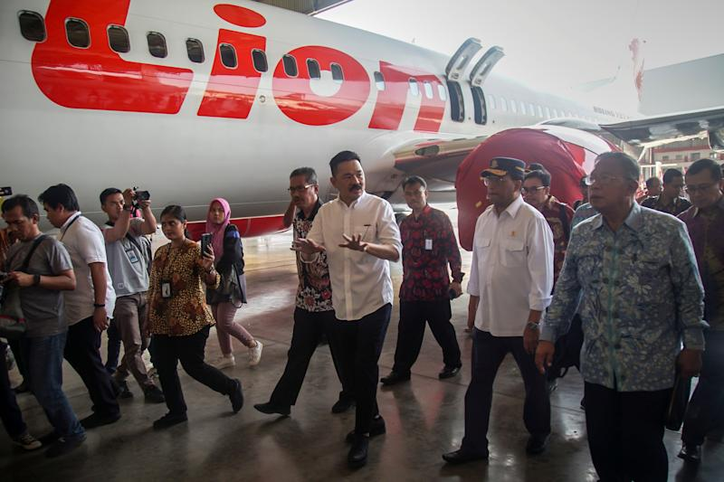 Founder of Lion Air Group Rusdi Kirana walks with Indonesia's Transport Minister Budi Karya Sumadi and Indonesia's Coordinating Minister of Economic Affairs Darmin Nasution, as they inspect the facilities of Batam Aero Technic (BAT) at Hang Nadim International airport in Batam island, Indonesia, August 14, 2019 in this photo taken by Antara Foto. Antara Foto/M N Kanwa/ via REUTERS ATTENTION EDITORS - THIS IMAGE WAS PROVIDED BY A THIRD PARTY. MANDATORY CREDIT. INDONESIA OUT.