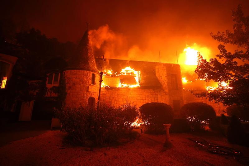 St. Helena's Chateau Boswell Winery is seen engulfed in flames Monday.