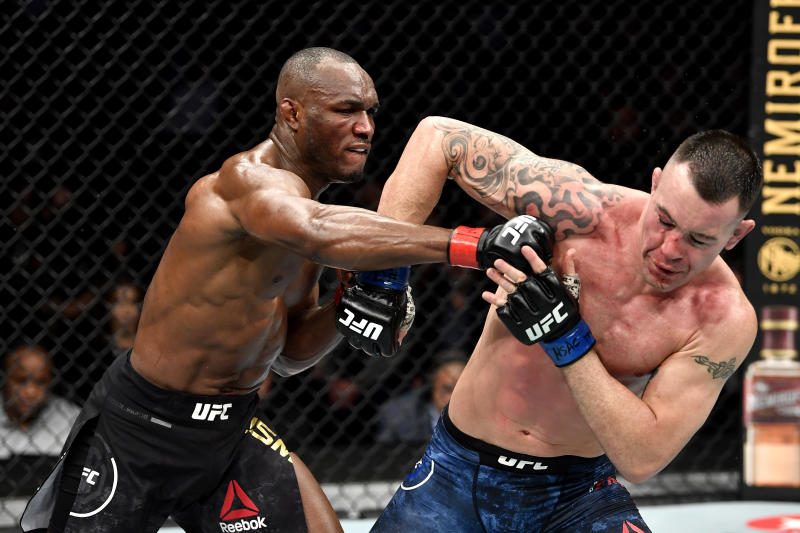LAS VEGAS, NEVADA - DECEMBER 14: (L-R) Kamaru Usman of Nigeria strikes Colby Covington in their UFC welterweight championship bout during the UFC 245 event at T-Mobile Arena on December 14, 2019 in Las Vegas, Nevada. (Photo by Jeff Bottari/Zuffa LLC via Getty Images)