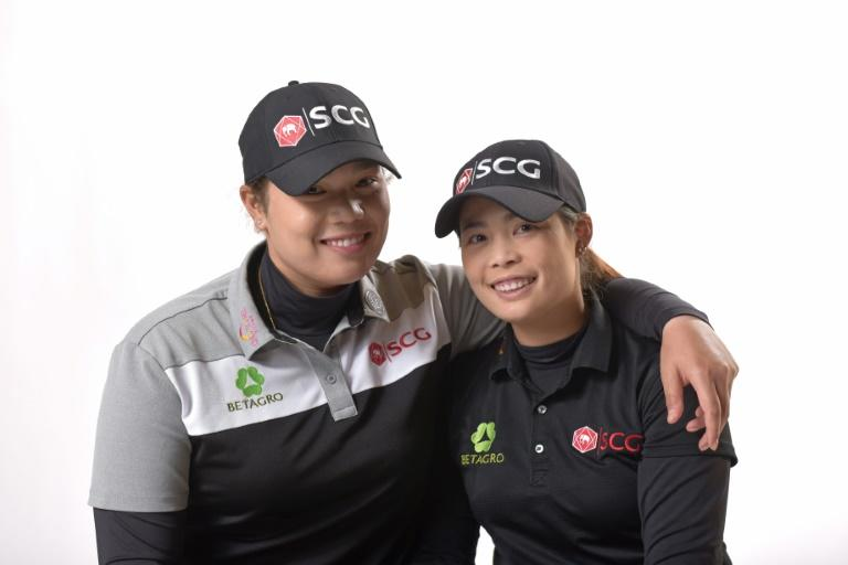 Sisters Moriya (R) and Ariya Jutanugarn of Thailand will play together in the Dow Great Lakes Bay Invitational, the LPGA's first official team event that tees off on Wednesday