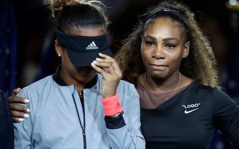 Naomi Osaka, left, of Japan, is hugged by Serena Williams - Credit: AP