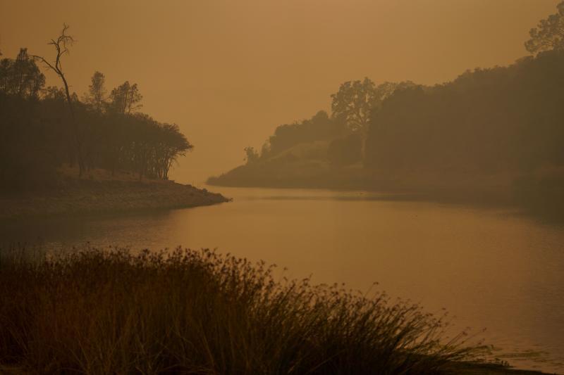 Smoke lingers overLake Hennessey in Napa County on Wednesday.