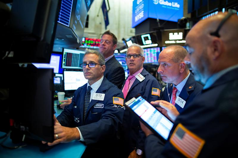 Traders work on the floor at the New York Stock Exchange (NYSE) in New York, U.S., August 12, 2019. REUTERS/Eduardo Munoz