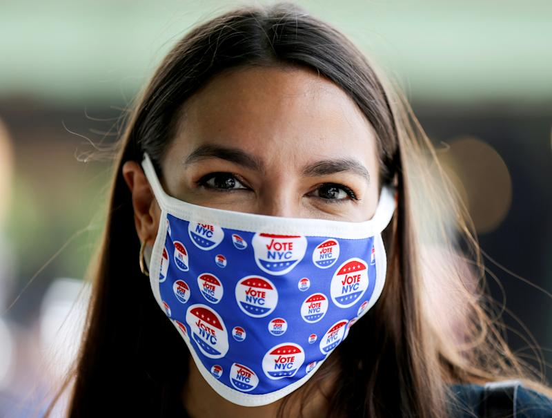 Rep. Alexandria Ocasio-Cortez (D-NY), stands for a portrait after voting early in the Democratic congressional primary election June 20, 2020. REUTERS/Caitlin Ochs/File Photo