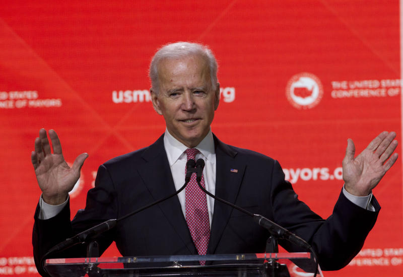"FILE - In this Jan. 24, 2019, file photo, Former Vice President Joe Biden speaks during the U.S. Conference of Mayors Annual Winter Meeting in Washington. Democratic presidential candidates are touting their support for ""Medicare-for-all,"" higher taxes on the wealthy and a war on climate change. But foreign policy is largely taking a back seat. Biden is seizing on that opening to position himself as the global policy expert if he decides to run for president. (AP Photo/Jose Luis Magana, File)"