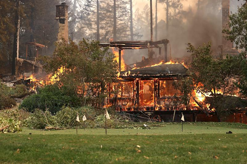 The main building at St. Helena's famousMeadowood Napa Valley luxury resort crumbles from the flames on Monday.