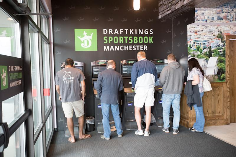 MANCHESTER, NH - SEPTEMBER 13: People places their bets after the ribbon cutting ceremony of the Grand Opening of DraftKings Sportsbook Manchester on September 2, 2020 in Manchester, New Hampshire. (Photo by Scott Eisen/Getty Images for DraftKings)