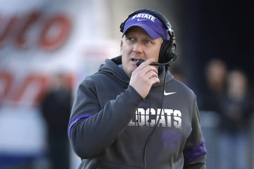 """FILE - In this Dec. 31, 2019, file photo, Kansas State coach Chris Klieman watches from the sideline during the first half of the team's Liberty Bowl NCAA college football game against Navy in Memphis, Tenn. The Big Ten and Pac-12 became the first Power Five conferences to cancel their fall football seasons because of concerns about COVID-19. The announcements left the Atlantic Coast Conference, the Southeastern Conference and the Big 12 as thePower Five conferences still intending to play in the fall, and left Klieman clinging to hope. I hope they don't totally lose a season,"""" he said of his players. (AP Photo/Mark Humphrey, File)"""