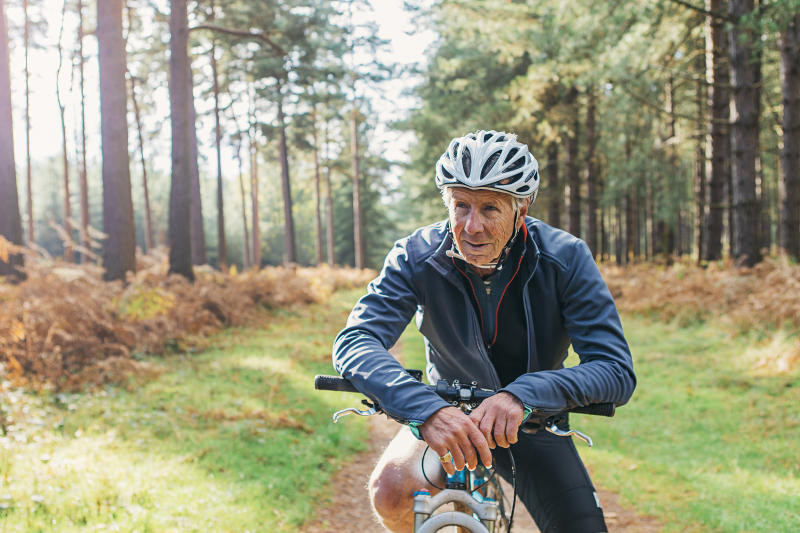 Senior male on bike in forest