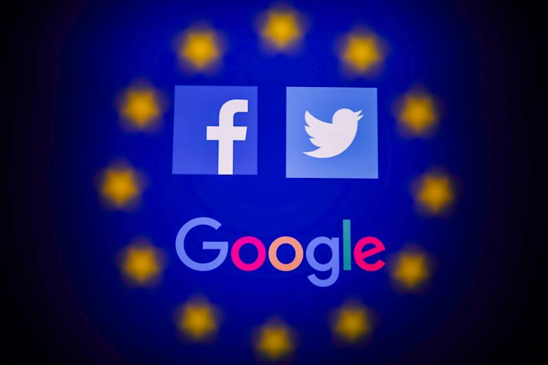 Facebook, Twitter and Google logos displayed on a phone screen and European Union flag displayed on a screen in the background are seen in this multiple exposure illustration photo taken in Poland on June 14, 2020. European Commission officials said that Facebook, Twitter and Google should provide monthly fake news reports to prevent fake news about coronavirus pandemic. (Photo Illustration by Jakub Porzycki/NurPhoto via Getty Images)