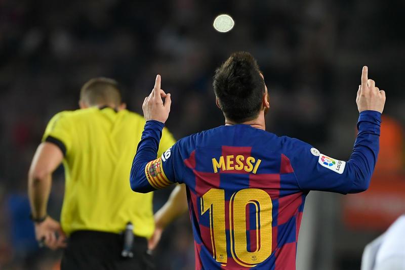 Lionel Messi (Photo by LLUIS GENE / AFP)