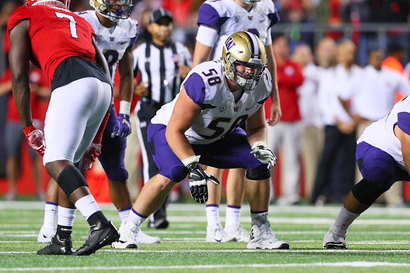 Kaleb McGary at Washington, wrecking fools. (Getty)