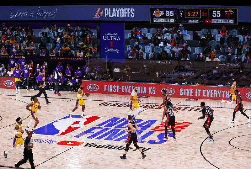 LAKE BUENA VISTA, FLORIDA - SEPTEMBER 30: The Los Angeles Lakers and the Miami Heat in action during the third quarter in Game One of the 2020 NBA Finals at AdventHealth Arena at the ESPN Wide World Of Sports Complex on September 30, 2020 in Lake Buena Vista, Florida. NOTE TO USER: User expressly acknowledges and agrees that, by downloading and or using this photograph, User is consenting to the terms and conditions of the Getty Images License Agreement. (Photo by Kevin C. Cox/Getty Images)