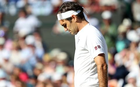 11th July 2018, All England Lawn Tennis and Croquet Club, London, England; The Wimbledon Tennis Championships, Day 9; Roger Federer (SUI) shows his frustration as the 5th set slips way - Credit: Getty Images