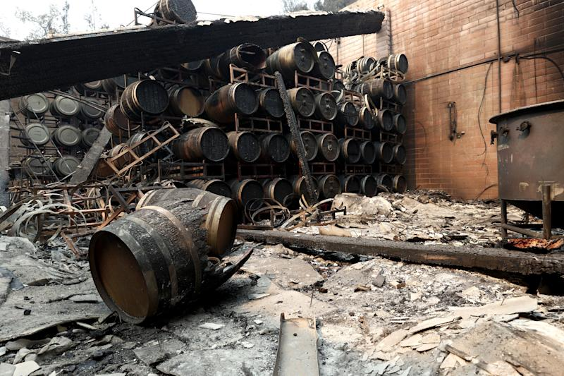 Damaged wine barrels sit stacked at Calistoga's Fairwinds Estate Winery on Tuesday.
