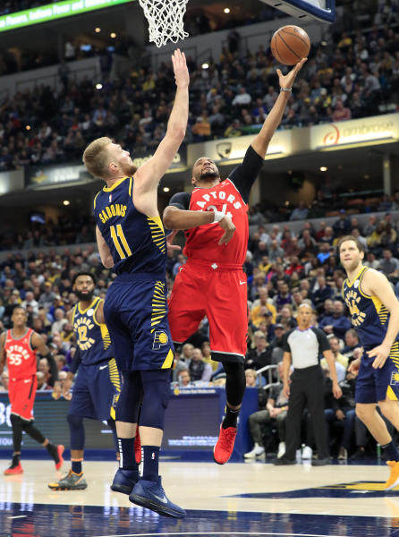 f3c49384cea1 Pacers beat Raptors after losing Oladipo with knee injury