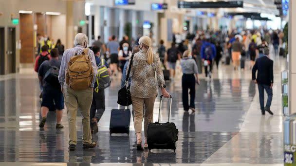 PHOTO: Passengers walk through the new terminal at the Salt Lake City International Airport, Sept. 15, 2020, in Salt Lake City. (Rick Bowmer/AP)