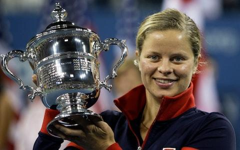 In this Sept. 13, 2009, file photo, Kim Clijsters holds the trophy after winning the women's championship over Caroline Wozniacki, at the U.S. Open tennis tournament in New York. Four-time Grand Slam champion Kim Clijsters is planning another comeback. A mother of three, the Belgian who retired after the 2012 U.S. Open wants a new challenge, she told the WTA in an interview on its website on Thursday, Sept. 12, 2019. - Credit: AP