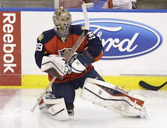 Florida Panthers goalie Dan Ellis warms up before the start of an NHL hockey game against the Tampa Bay Lightning, Saturday, April 4, 2015 in Sunrise, Fla. (AP Photo/Wilfredo Lee)
