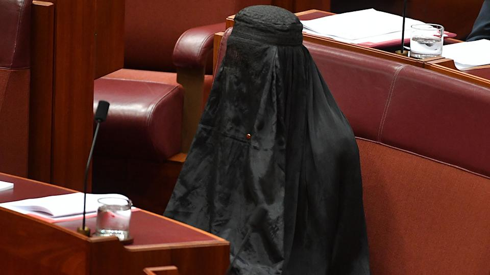 Australia's One Nation party leader wears black burqa and enters senate chamber