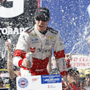 Brad Keselowski celebrates winning the NASCAR Sprint Cup Series auto race in Fontana, Calif., Sunday, March 22, 2015. (AP Photo/Alex Gallardo)