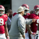 In a March 27, 2015, photo Alabama defensive lineman Jonathan Taylor (53) works through drills during Alabama's spring NCAA football practice at the Thomas-Drew Practice Fields in Tuscaloosa, Ala. Taylor was removed from the Alabama team Monday, March 30, 2015, after a domestic violence arrest over the weekend. (AP Photo/AL.com, Vasha Hunt)