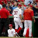 Washington Nationals starting pitcher Stephen Strasburg (37) walks with pitching coach Steve McCatty, right, to the clubhouse after he was relieved during the fourth inning of a baseball game against the San Francisco Giants at Nationals Park, Saturday, July 4, 2015, in Washington. (AP Photo/Alex Brandon)