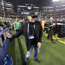 FILE - In this Monday, Jan. 12, 2015, file photo, Nike Chairman Phil Knight walks near the field before the NCAA college football playoff championship game between Ohio State and Oregon in Arlington, Texas. Knight plans to step down and says he wants Nike President and CEO Mark Parker to succeed him. (AP Photo/David J. Phillip, File)