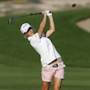 Melissa Reid of Britain takes a shot on the 14th hole during the third round of the Dubai Ladies Masters December 12, 2014. REUTERS/Caren Firouz