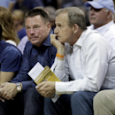 FILE - In this May, 2015 file photo, Tennessee head football coach Butch Jones, center, and head basketball coach Rick Barnes, right, watch the first half of Game 4 of a second-round NBA basketball Western Conference playoff series between the Memphis Grizzlies and the Golden State Warriors in Memphis, Tenn. The new coaching quartet of Barnes, Avery Johnson, Ben Howland and Mike White will join the rest of the SEC in looking to knock off John Calipari and his Kentucky Wildcats. (AP Photo/Mark Humphrey, File)
