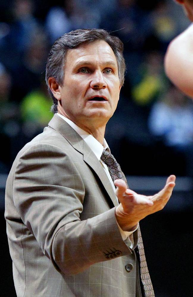 Utah Valley coach Dick Hunsaker gestures to a player during the first half of an NCAA college basketball game against Oregon in Eugene, Ore., Tuesday, Nov. 19, 2013
