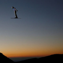 Qi Guangpu of China performs an aerial as he trains during the Snowboarding and Freestyle Skiing World Championships in Sierra Nevada, Spain, March 9, 2017.  REUTERS/Paul Hanna