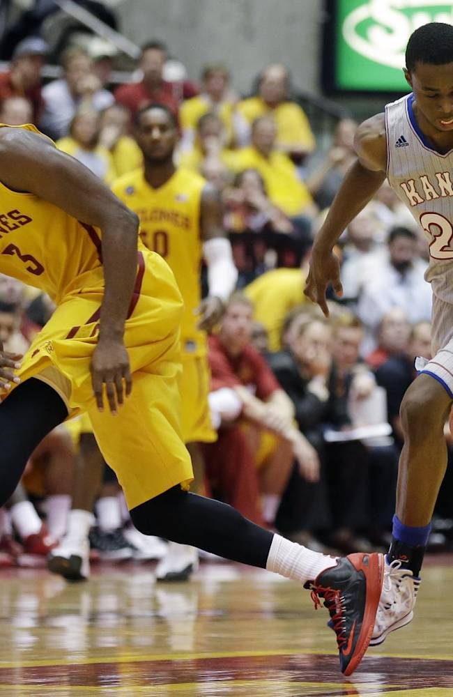 Kansas guard Andrew Wiggins, right, drives past Iowa State forward Melvin Ejim during the second half of an NCAA college basketball game, Monday, Jan. 13, 2014, in Ames, Iowa. Kansas won 77-70