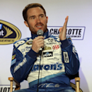Driver Brian Vickers speaks to the media during the NASCAR Charlotte Motor Speedway media tour in Charlotte, N.C., Tuesday, Jan. 27, 2015. (AP Photo/Chuck Burton)