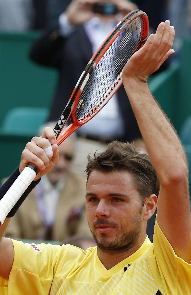Stanislas Wawrinka of Switzerland acknowledges applause after defeating Marin Cilic of Croatia 6-0 6-2 during their match of the Monte Carlo Tennis Masters tournament in Monaco, Wednesday, April 16, 2014