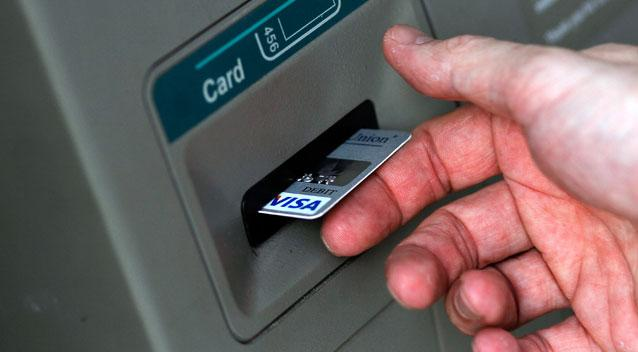Man stuck in cashpoint slips 'help me' note through slot