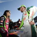 Dale Earnhardt Jr., and Danica Patrick talk before qualifying for Sunday's NASCAR Sprint Cup Series auto race at Talladega Superspeedway Saturday, Oct. 18, 2014, in Talladega, Ala. (AP Photo/Rainier Ehrhardt)