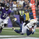 San Diego Chargers wide receiver Keenan Allen, right, makes a diving catch for a touchdown in front of Baltimore Ravens cornerback Lardarius Webb in the first half of an NFL football game, Sunday, Nov. 30, 2014, in Baltimore. (AP Photo/Nick Wass)